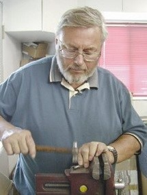 Master gunsmith Bob Dunlap teaches gunsmithing classes on firing pins.