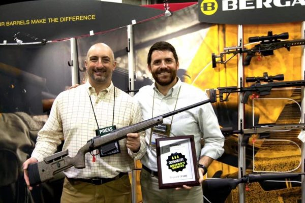 John B. Snow, Outdoor Life Shooting Editor, Presenting Bergara with Editor's Choice award.