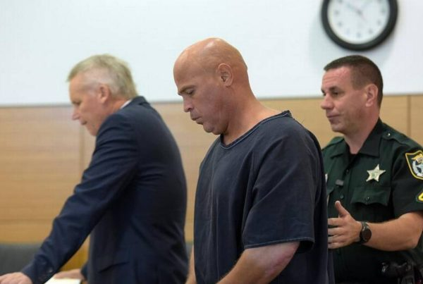 Delmer Smith escorted by deputies into court. (Photo by Tiffany Tompkins, courtesy of Bradenton Herald).