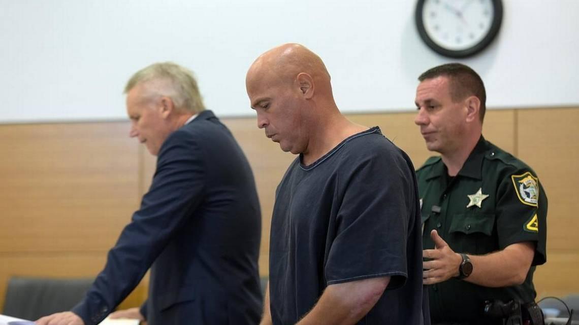 Delmer Smith escorted by deputies into court. (Photo by Tiffany Tompkins, courtesy of Bradenton Herald).
